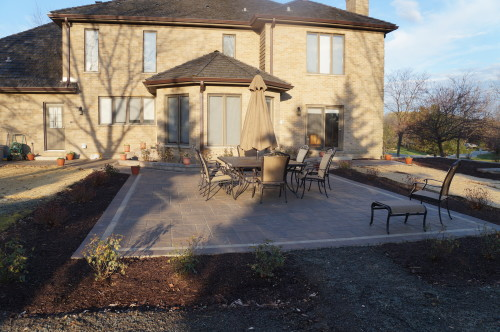 Backyard concrete patio with a large seating aera
