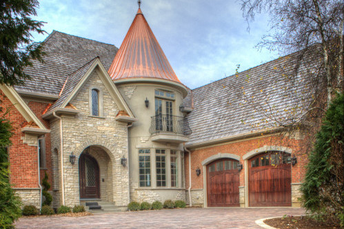 A beautiful country castle style home, with a brick paved driveway