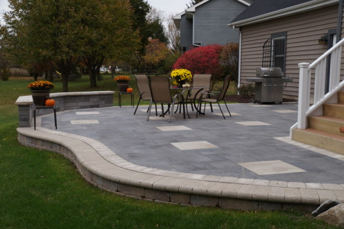 ... Backyard Brick Paver Patio Leading To A Two Story Deck
