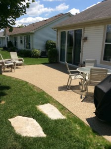 Backyard concrete patio with a nice seating aera