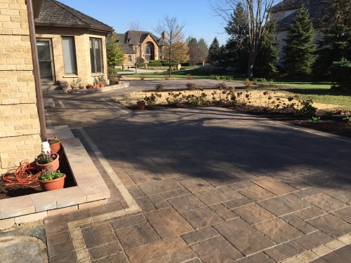 Brick paver patio in a backyard