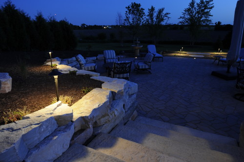 Night time well lit brick paver patio