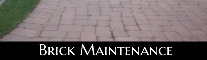 Poorly maintained brick driveway