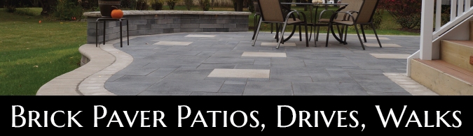 Brick paver patio leading to a deck